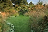 Lawn and path of garden edging massifs of flowers France
