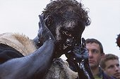 "Carnival "" The day of the bear "" in Prats of Mollo ; Faces and hands of the bears are coated with soot and with oil"