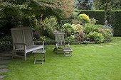 Garden furnitures and perennials flowerbed in autumn