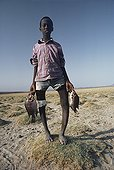 El-Molo children suffer from Rickets Lake Turkana Kenya ; Because of a diet consisting primarily of fish, the el-Molo children suffer from Rickets, a nutritional disease which causes done deformities such as bowlegs or knocknees.