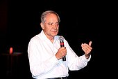 Andre Brahic at a conference France ; It is famous for having discovered the rings of Neptune
