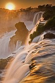 View of the rising sun over the falls of Iguazu Argentina