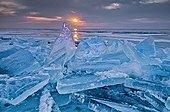Shards of ice against the rising sun Minnesota USA
