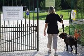 Volunteer walking with a dog from a refuge SPA France