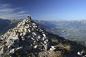 Cairn of the Pic de Morgon and Embrun Hautes-AlpesFrance ; View of Lake Serre-Ponçon, the water of Embrun, the Durance, the town of Embrun and the valley to Briancon. 2327m
