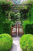 Garden entrance gate under a pergola