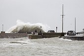 Wave over a dam during the storm XynthiaFrance ; Xynthia was a violent European windstorm which crossed Western Europe on 26–28 February 2010.