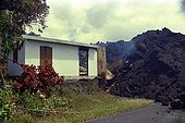 Eruption of the volcano Piton de la Fournaise in Reunion  ; The lava comes from crossing the national highway No. 1 and headed toward the sea, destroying houses in its path
