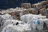 Bales of plastic and cardboard waste outside warehouse UK