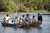 Watching Jaguars boat Encontros das Aguas Pantanal Brazil  ; Search for Jaguars by Boat