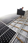 Installing solar panels on the roof of a farm building