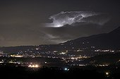 Cumulonimbus illuminated by lightning in Haute-Savoie France ; Photo taken from the Mound Servolex