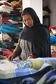 Women posing on a pattern of tissue Kathmandu Nepal