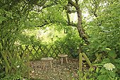 Resting area for children under the Apple Le Jardin des Lianes ; Le jardin des lianes
