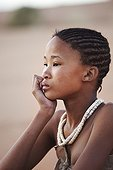 """Young girl San wearing traditional skins Namibia ; In the private reserve named """"N/a'an ku sê"""", welfare programs and health support converge to maintain populations of Bushmen in good health and to reintroduce the wild Cheetahs. This nomadic group of hunter-gatherers has a history dating back over 20,000 years. Their close relationship and perfect their knowledge of animals allowed to live and feed in the deserts of southern Africa."""