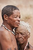 """Husband and wife San in Namibia ; In the private reserve named """"N/a'an ku sê"""", welfare programs and health support converge to maintain populations of Bushmen in good health and to reintroduce the wild Cheetahs. This nomadic group of hunter-gatherers has a history dating back over 20,000 years. Their close relationship and perfect their knowledge of animals allowed to live and feed in the deserts of southern Africa."""