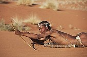 """Male San hunter armed with traditional bow and arrow ; In the private reserve named """"N/a'an ku sê"""", welfare programs and health support converge to maintain populations of Bushmen in good health and to reintroduce the wild Cheetahs. This nomadic group of hunter-gatherers has a history dating back over 20,000 years. Their close relationship and perfect their knowledge of animals allowed to live and feed in the deserts of southern Africa."""