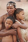 """Farther San embracing his children Namibia ; In the private reserve named """"N/a'an ku sê"""", welfare programs and health support converge to maintain populations of Bushmen in good health and to reintroduce the wild Cheetahs. This nomadic group of hunter-gatherers has a history dating back over 20,000 years. Their close relationship and perfect their knowledge of animals allowed to live and feed in the deserts of southern Africa."""