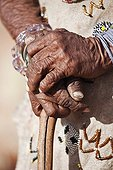 """Close-up of the hands of an elderly San woman Namibia ; In the private reserve named """"N/a'an ku sê"""", welfare programs and health support converge to maintain populations of Bushmen in good health and to reintroduce the wild Cheetahs. This nomadic group of hunter-gatherers has a history dating back over 20,000 years. Their close relationship and perfect their knowledge of animals allowed to live and feed in the deserts of southern Africa."""