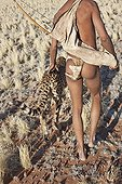 """San hunter armed with traditional bow and arrow with cheetah ; In the private reserve named """"N/a'an ku sê"""", welfare programs and health support converge to maintain populations of Bushmen in good health and to reintroduce the wild Cheetahs. This nomadic group of hunter-gatherers has a history dating back over 20,000 years. Their close relationship and perfect their knowledge of animals allowed to live and feed in the deserts of southern Africa."""