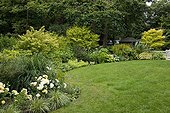 Lawn borded with mixed-border in a garden