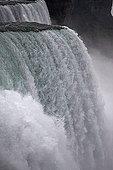 Close-up of water cascading over the Niagara Falls USA