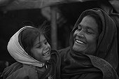 Woman in the streets and his daughter smiling Kathmandu Nepal