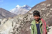 Portrait of a young boy carrying Gunsang Nepal Himalayas