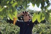 TEENAGER BIRDWATCHING ; TEENAGER birdwatching in summer UK
