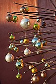 Artificial Christmas tree with balls on a garden terrace