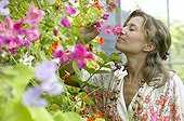 Woman smelling sweet peas