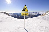 Sign indicating a dangerous access on a ski slope France ; overlooking the Mediterranean Sea to the top of slopes
