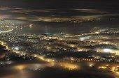 Fog and light pollution on the city of Geneva Switzerland