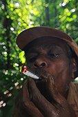 Female Pygmy Baaka, smoking Southeast Cameroon