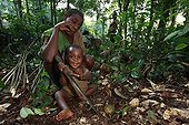 Pygmy Baaka child playing with a machete Cameroon ; All young children are already learning to use a machete, the basic tool of elementary