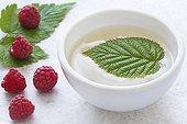 Raspberry leaf tea in a white bowl