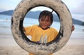 Girl playing with a tire Perhentian Kecil Malaysia