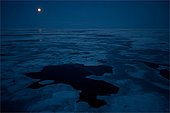 Moon over the ice of Baffin Bay Canada