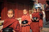 Young monks doing the quest with their bowl in Burma