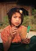 Girl playing cards in a village in Burma