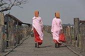 Nuns walking on the bridge of U Bein of Amarapura Myanmar