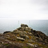 Rocky shore and Beacon Chausey Normandy France