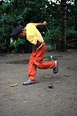 Boy playing with a top Gangga Lombok Indonesia