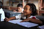 Schoolgirl listening in class Gangga Lombok Indonesia