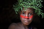 Boy with cap and paint Papua New-Guinea