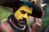 Portrait of a Huli man making up Papua New-Guinea