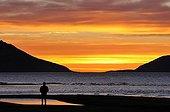 People at sunset Carlsberg Fjord Greenland