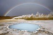Rainbow above Bláhver blue spring Iceland