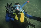 Nine year old free diver scuba diving Plum Cove USA