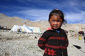 Tibetans girl before a camp Ladakh Himalayas India